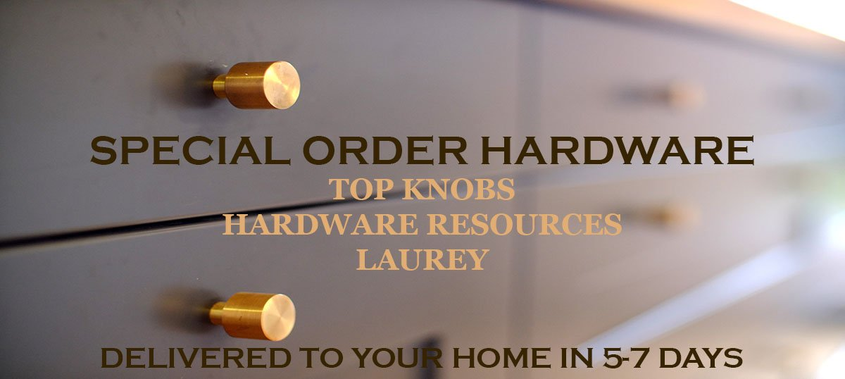 Small brass knobs on grey kitchen drawers